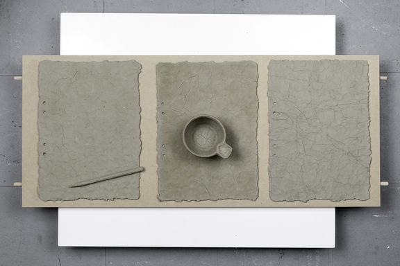 bredde_1600_from lumps of materia. unfired clay, paper, wood, plastic, glue, mdf board. 32x9x79 cm. 2014. photo, Håkan Lidman