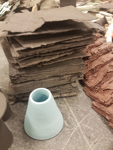 Thin layers of paper clay.